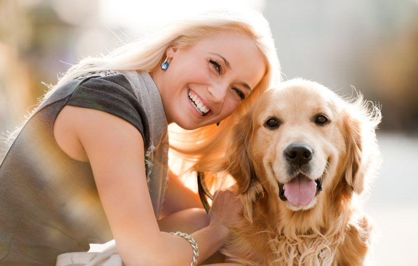 Woman with her Golden Retriever. Source: iStock.com