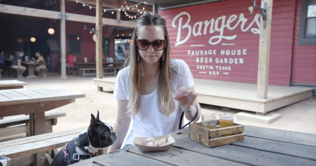 Amber and Olive enjoy Bangers, a dog-friendly restaurant in Austin