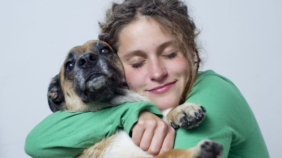 Woman hugs dog - Rover search
