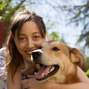 Woman with dog - loving dog sitters at Rover.com