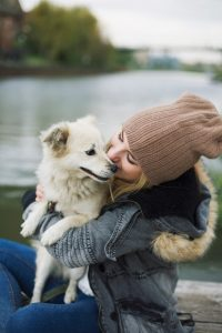 Woman hugs dog - loving dog sitters at Rover.com