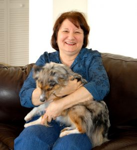 Woman with dog - become a dog sitter with Rover.com