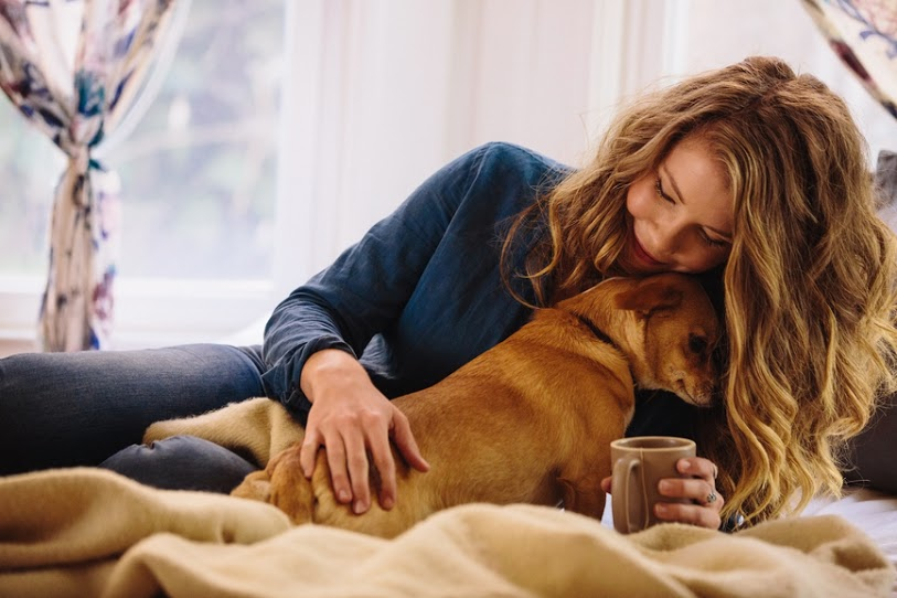 Woman and dog snuggle - Rover.com