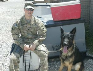 Army Spc. Devin Cooper with his MWD Panter in Afghanistan. Photo courtesy of Spc. Cooper.