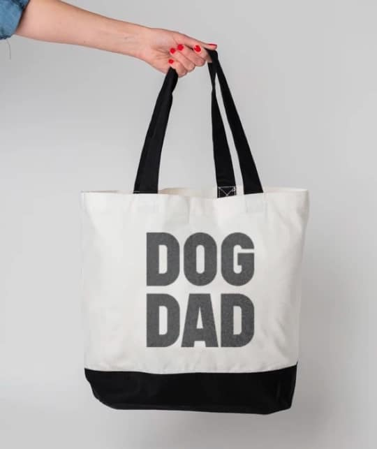 """white tote reading, """"dog dad"""" in bold black letters"""