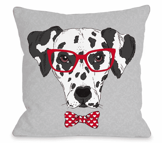 Dalmatian wearing glasses on a pillow