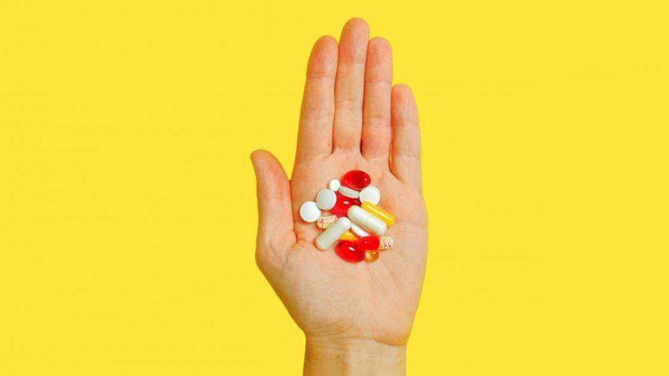 hand full of vitamins