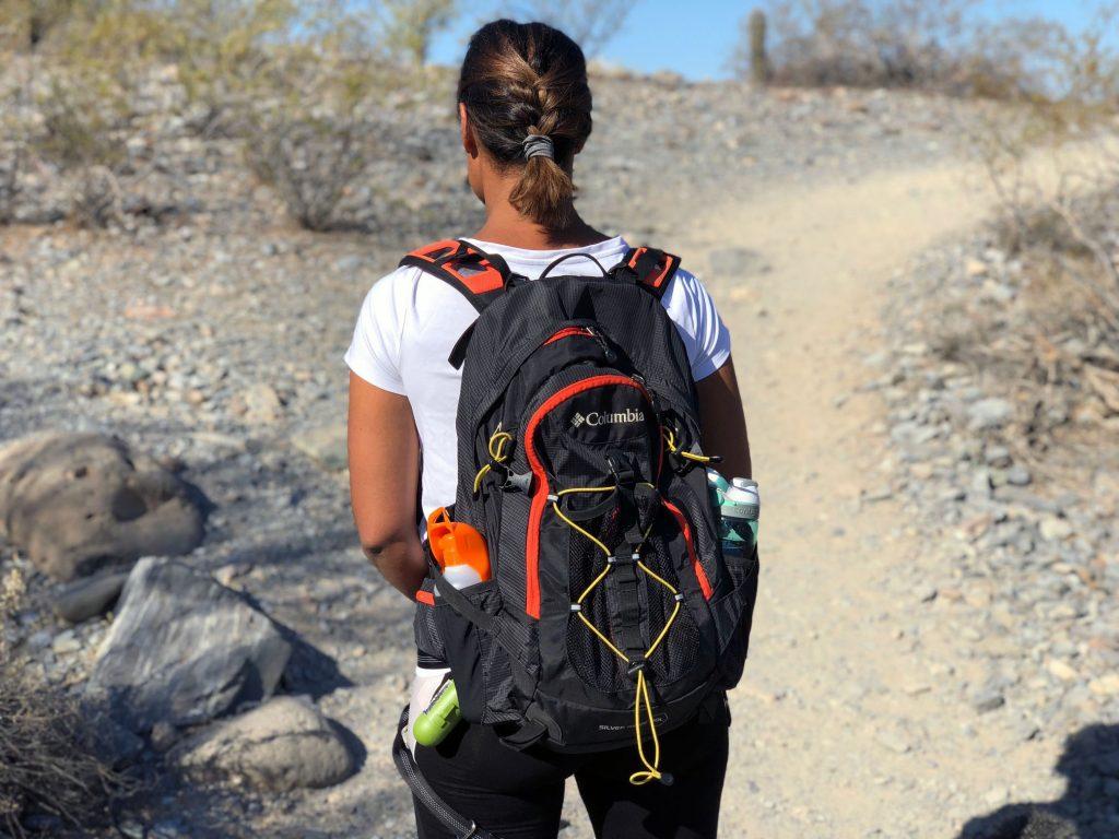 Melanie models her hiking backpack filled with dog hiking basics