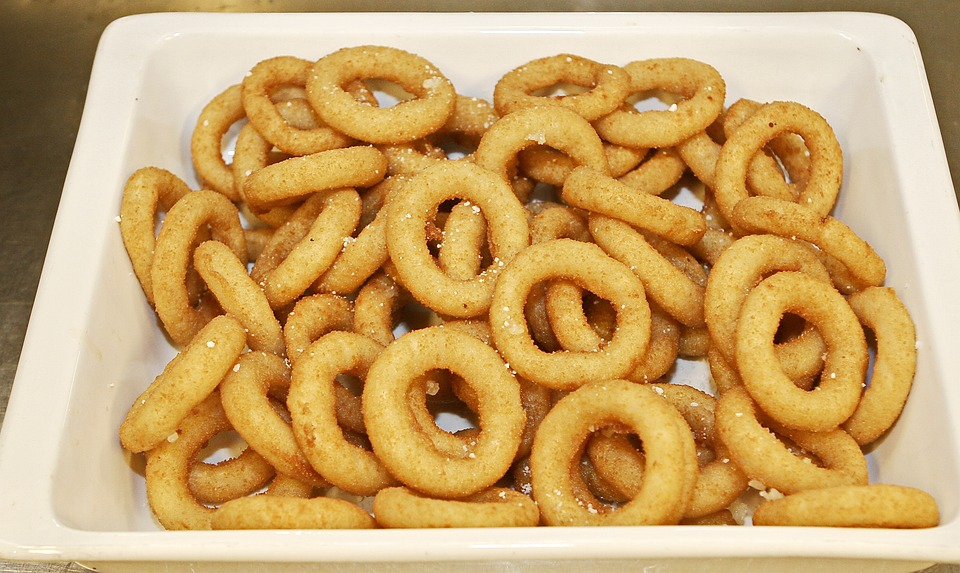 A plate of onion rings, which are toxic to dogs.
