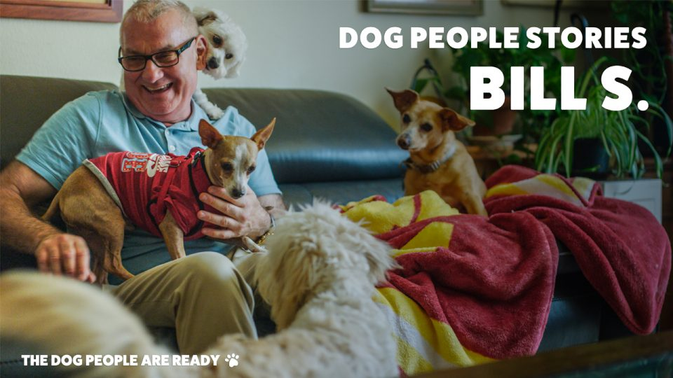 Bill S sitting with dogs.