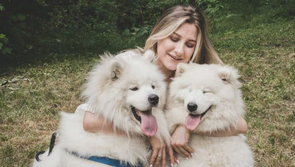 Woman hugging dogs