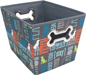 gray fabric dog toy bin with colorful dog commands printed on it