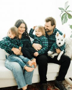 family and puppy wearing matching Lonesome Pine green and blue flannel