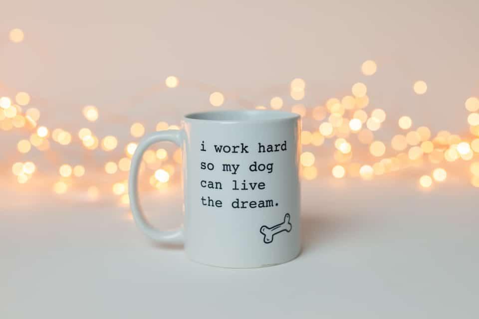 """white mug that says, """"I work hard so my dog can live the dream."""""""