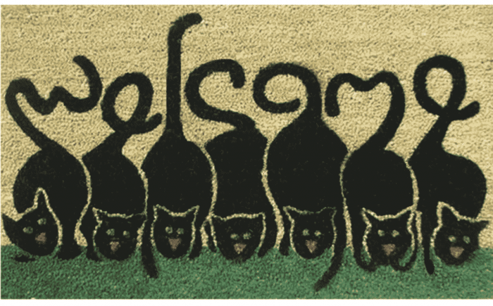 Welcome mat with cat tails shaping the message