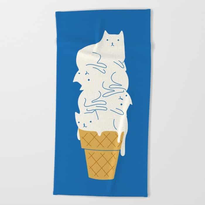 beach towel with melting kitties on an ice cream cone