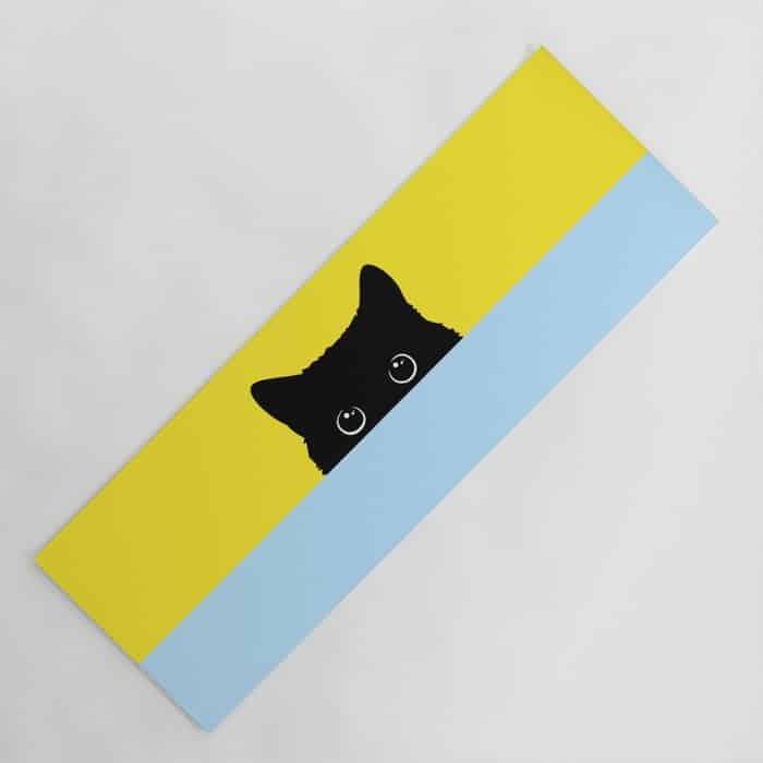 yellow and blue background yoga mat with kitty peeking