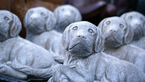 8 Dog Statues & Stones to Enrich Your Garden