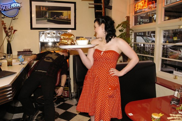 1940s woman dressed in red serving at the Diner: DogBuddy's dog-friendly coffee shops in Edinburgh
