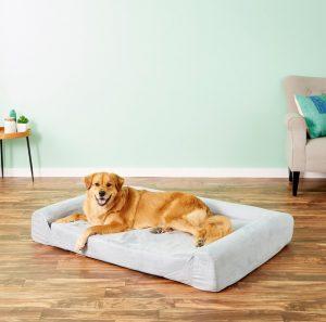 dog lounging on Kopeks sofa-style memory foam bed