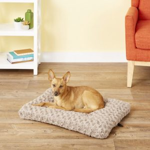 dog lounging on Midwest swirl dog crate mat