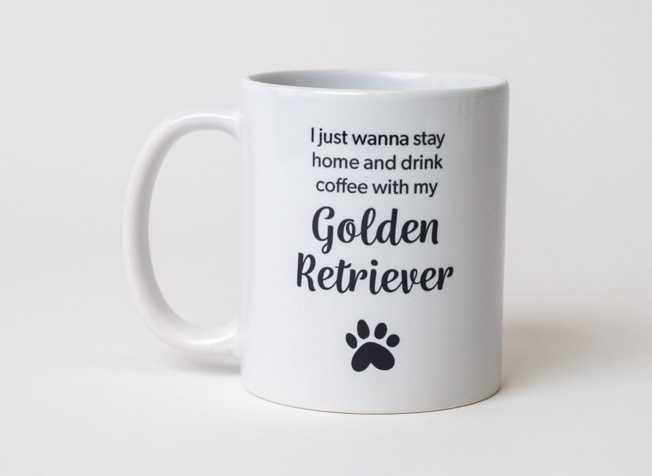 """A mug reading, """"I'd rather be drinking coffee with my Golden Retriever"""" with a paw print"""