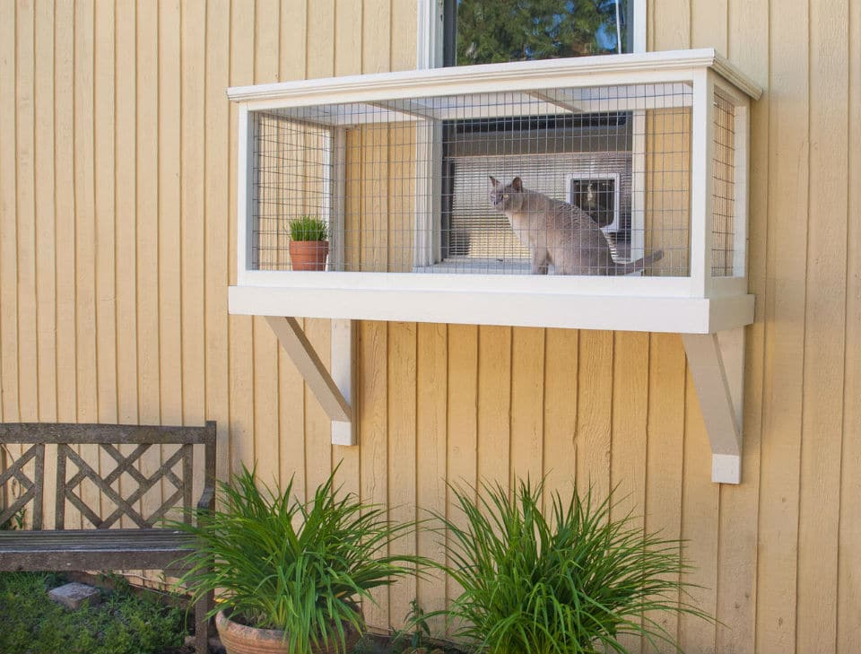 a three-sided catio attached to the home