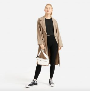 woman in trench coat and black Everlane Perform legging