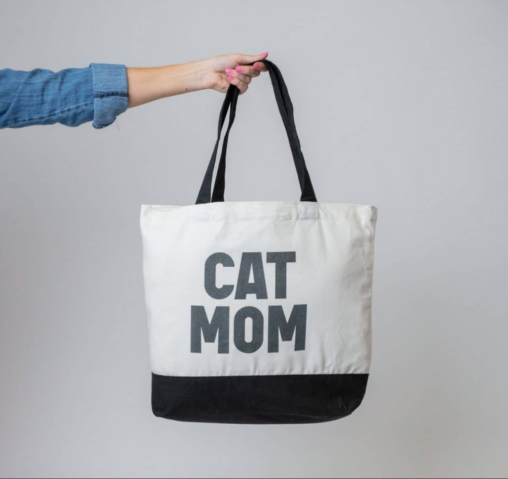 "A black and white tote reading, ""Cat Mom"""