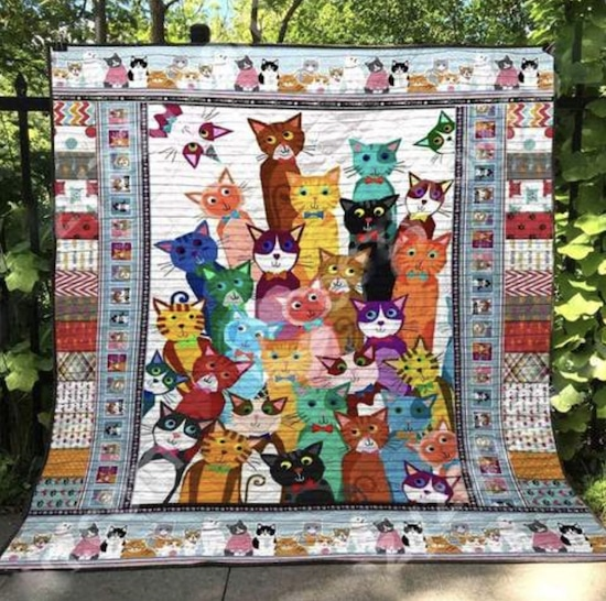 quilt with image of many colorful cats gathered