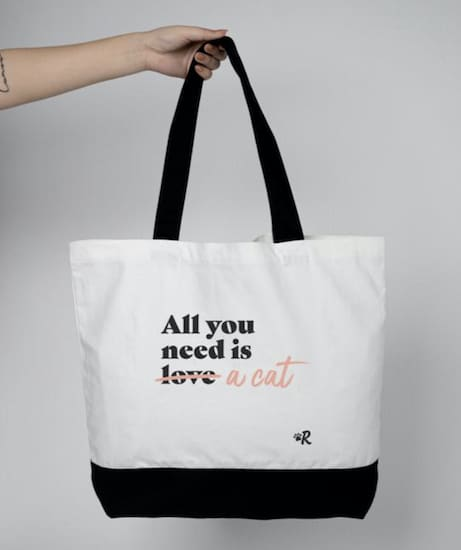 """All you need is a cat"" white tote bag with black trim"