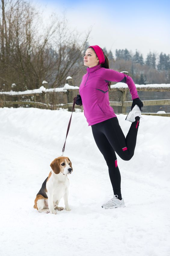 Woman stretching with dog - 123RF