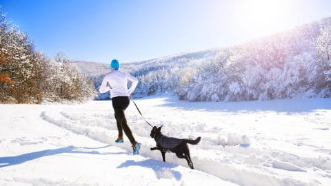 Man Running with Dog in Winter - 123RF