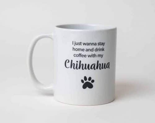 "A mug reading, ""I'd rather be drinking coffee with my Chihuahua"" with a paw print"