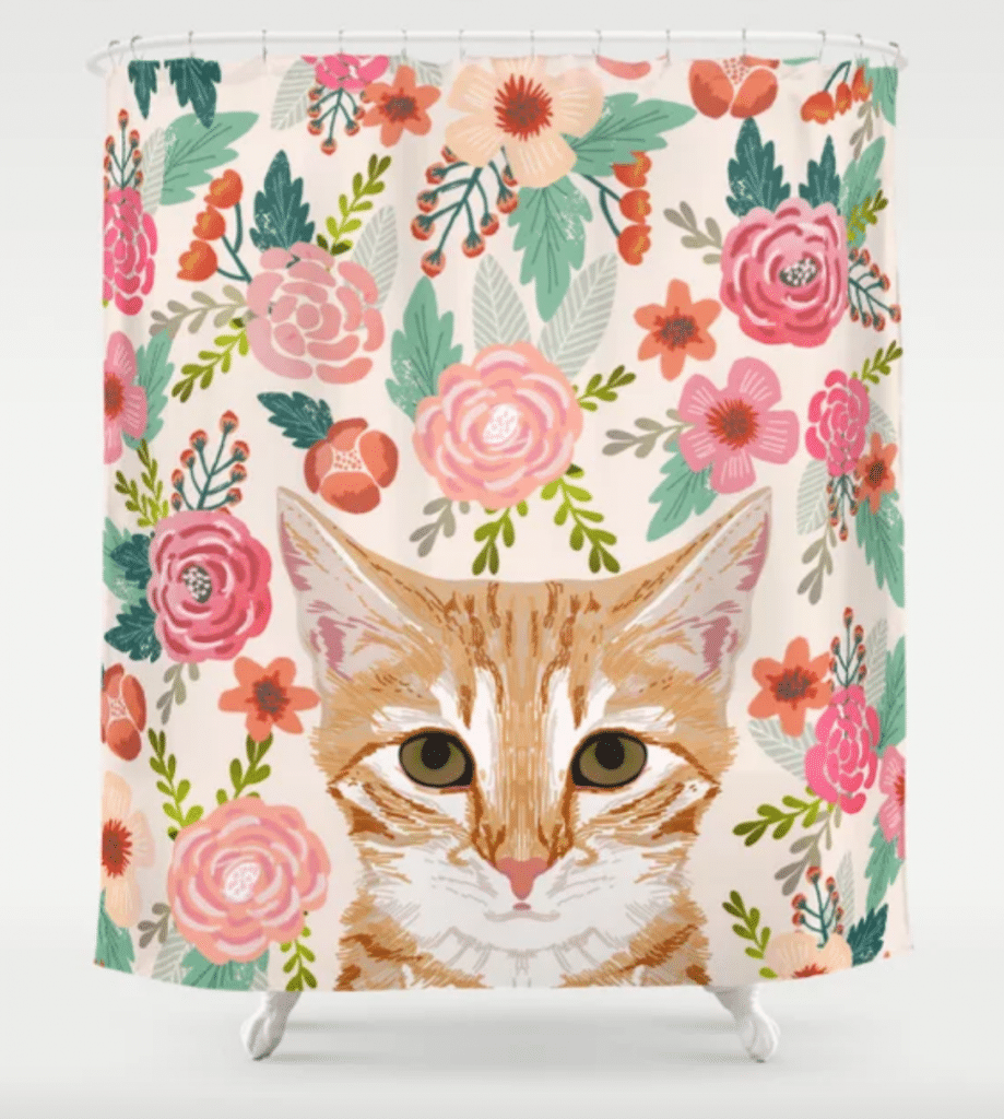 orange tabby and floral shower curtain