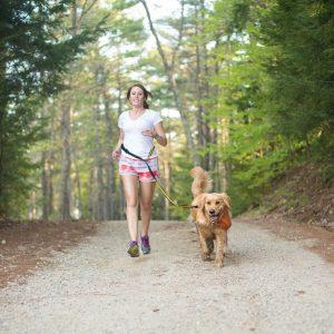 woman running with dog on Kurgo Quantum hands-free leash