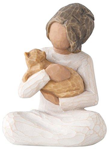 wooden figurine, woman holding orange cat