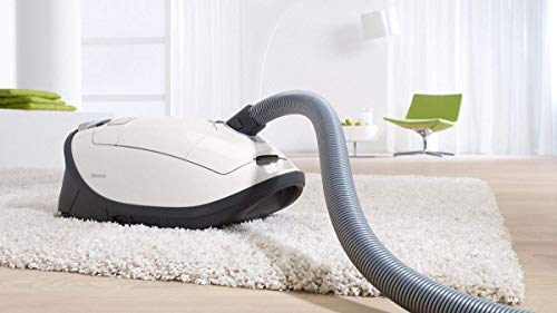 White canister of Miele C3 Cat and Dog Vacuum