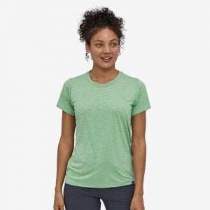 woman in green Patagonia Capilene dog mom clothing
