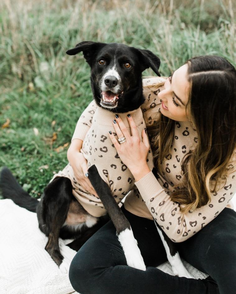 dog mom and dog wearing matching animal print sweaters