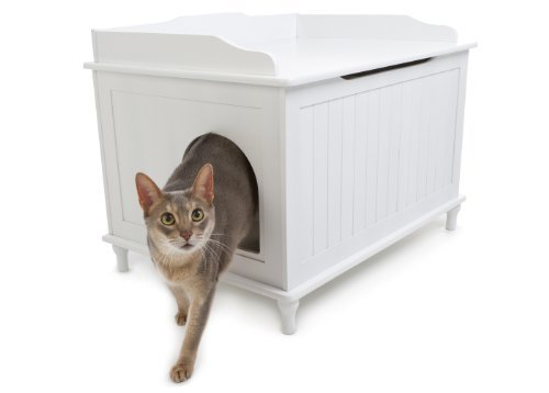 cat coming out of white sideboard with litter box inside