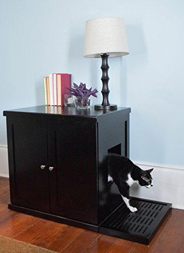 black and white cat coming out of black sideboard
