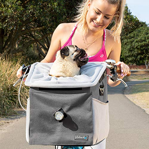 woman on bike with pug in Elabark 4-in-1 dog carrier