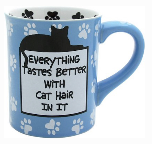 """blue mug with cat paw prints and text, """"Everything tastes better with cat hair in it."""""""