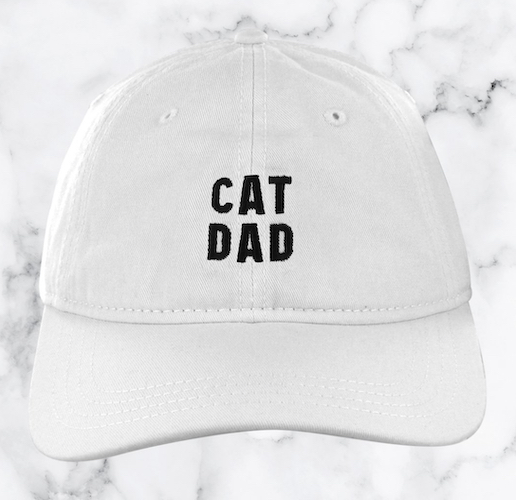 "white hat with ""Cat Dad"" embroidery"