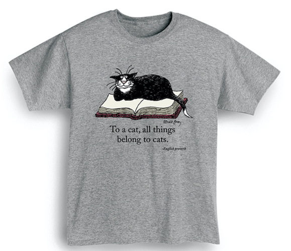 gray t-shirt with cat on book