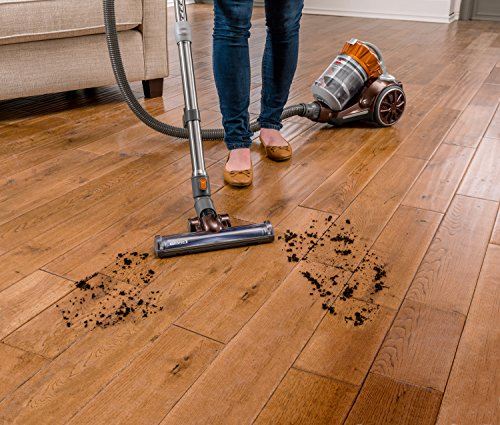 Bissell corded bagless canister vacuum in action on hardwood floor