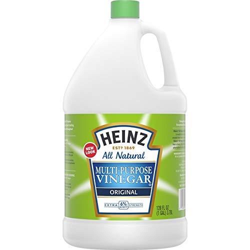 bottle of vinegar for pet safe cleaning