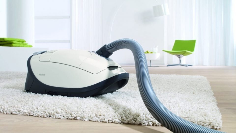 Miele pet hair vacuum on a rug in stylish modern home