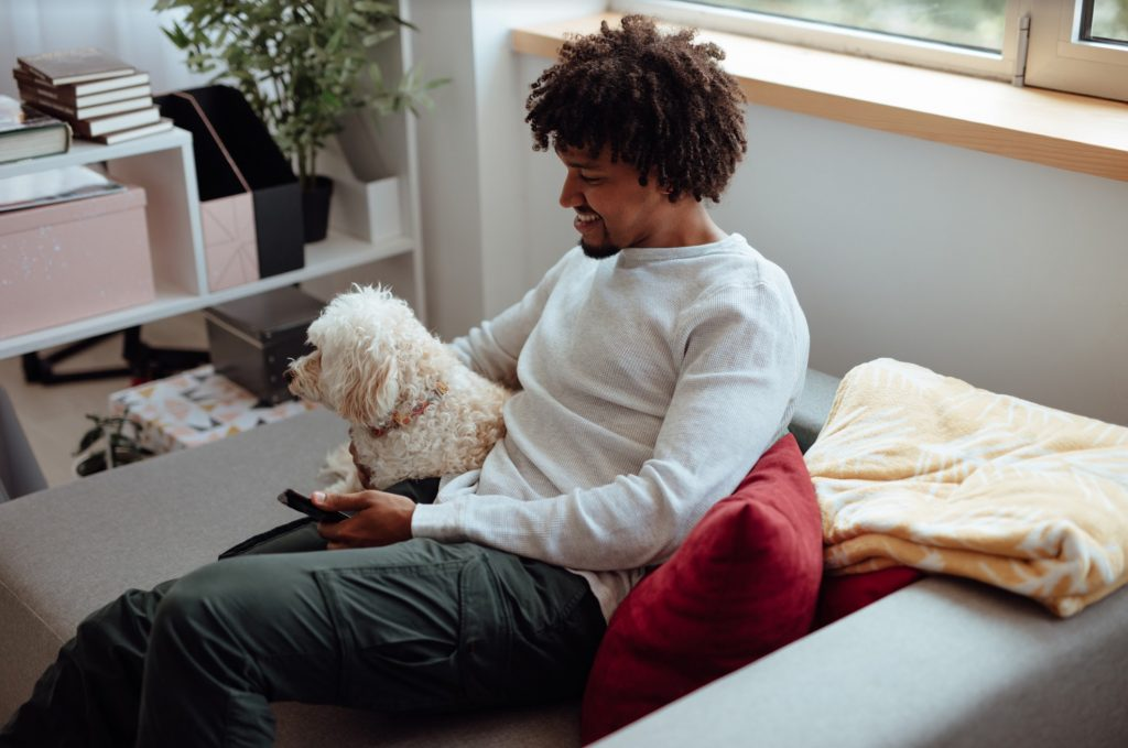 Getty man and dog watching TV